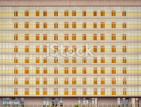 178842131 istock photo Huge building with many flats 874457340
