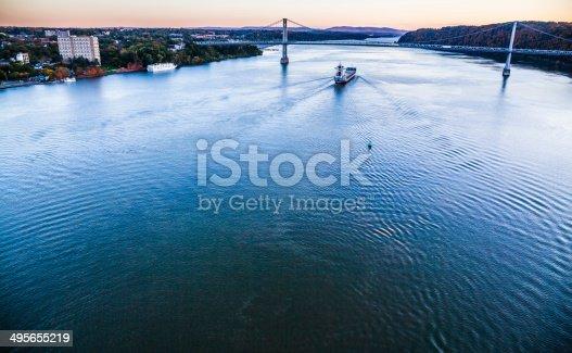 483418977istockphoto Huge cargo ship at the Hudson River 495655219