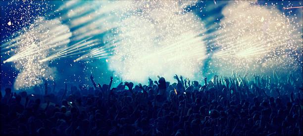 Huge cheering crowd at concert stock photo