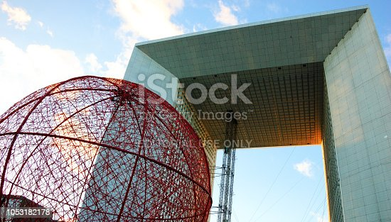 istock Huge Christmas ball decoration and Grande Arche in La Defense - the major business district of Paris and largest open-air contemporary art gallery in France. 1053182178
