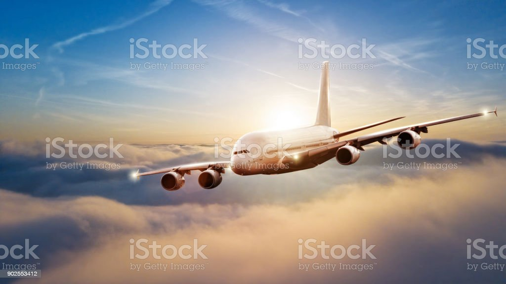 Huge commercial airplane flying above clouds stock photo