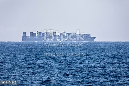 Mirissa, Sri Lanka - December 17, 2017:A container ship south of Sri Lanka. A big part of the export from Asia to Europe are sailed around India and Sri Lanka on the way to the consumers
