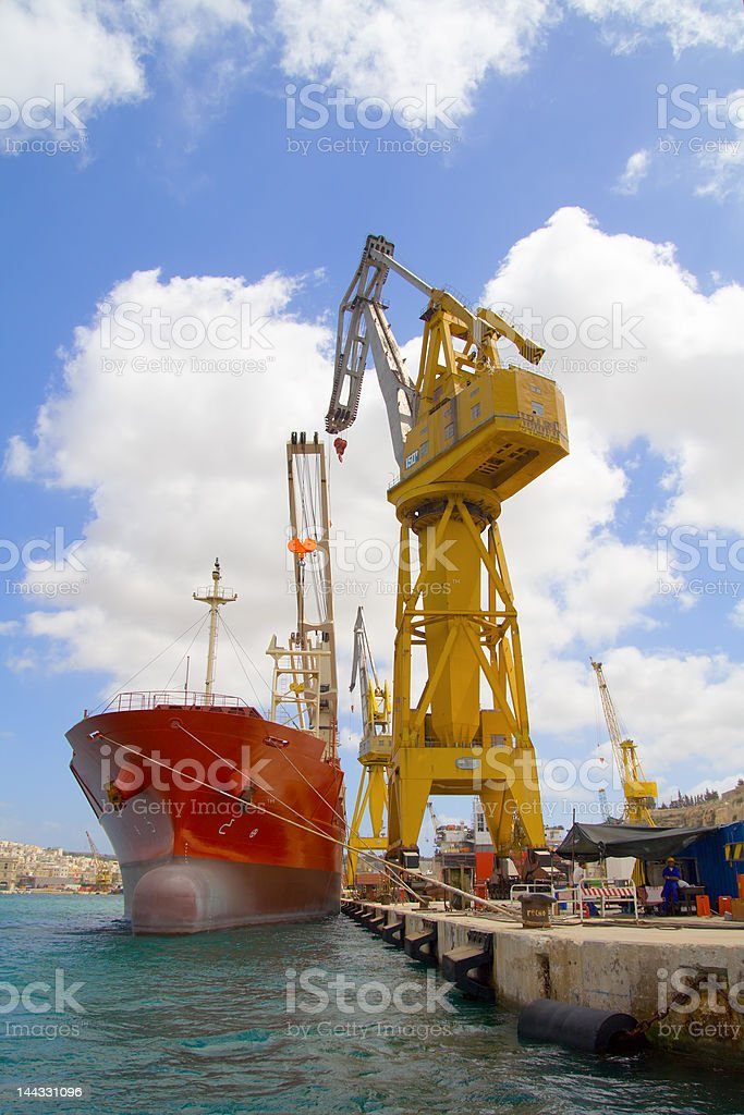 Huge Crane loading a Container Ship stock photo