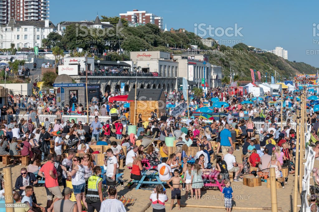 Huge crowds of people on the seafront in Bournemouth stock photo