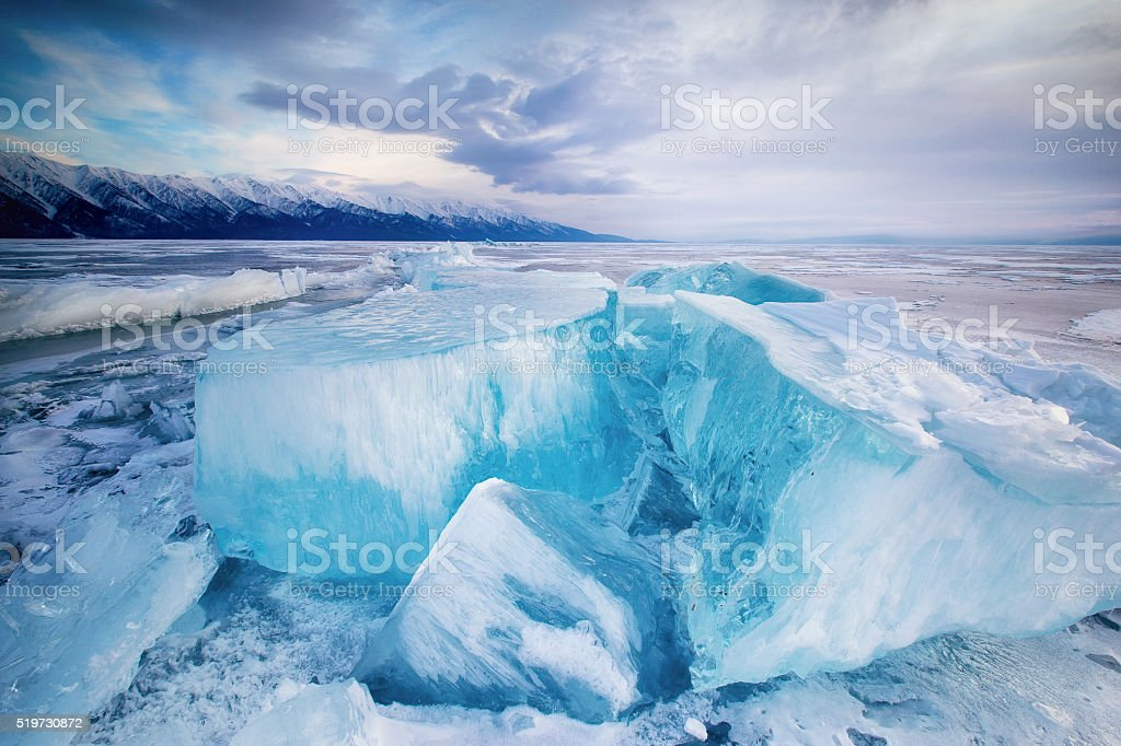 Huge cubes of ice on the frozen Lake Baikal stock photo