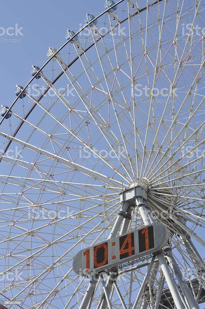 Huge digital clock on Ferris wheel royalty-free stock photo