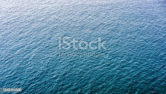 1143575463 istock photo Huge, distant area of rippled tranquil sea surface 1045454300