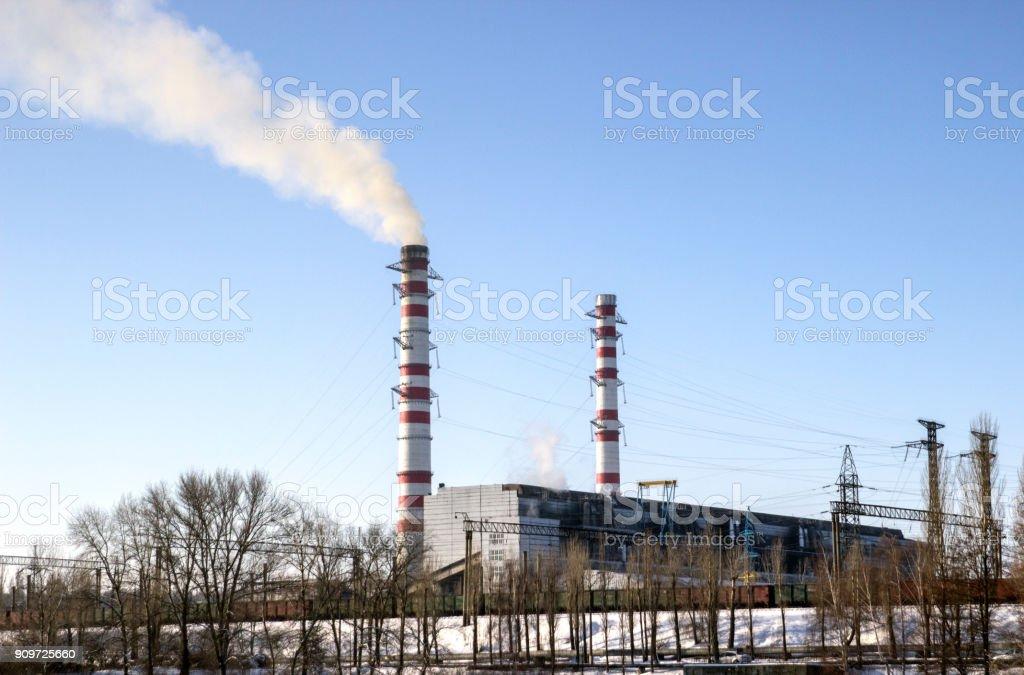 Huge factory is working, huge tubes stock photo