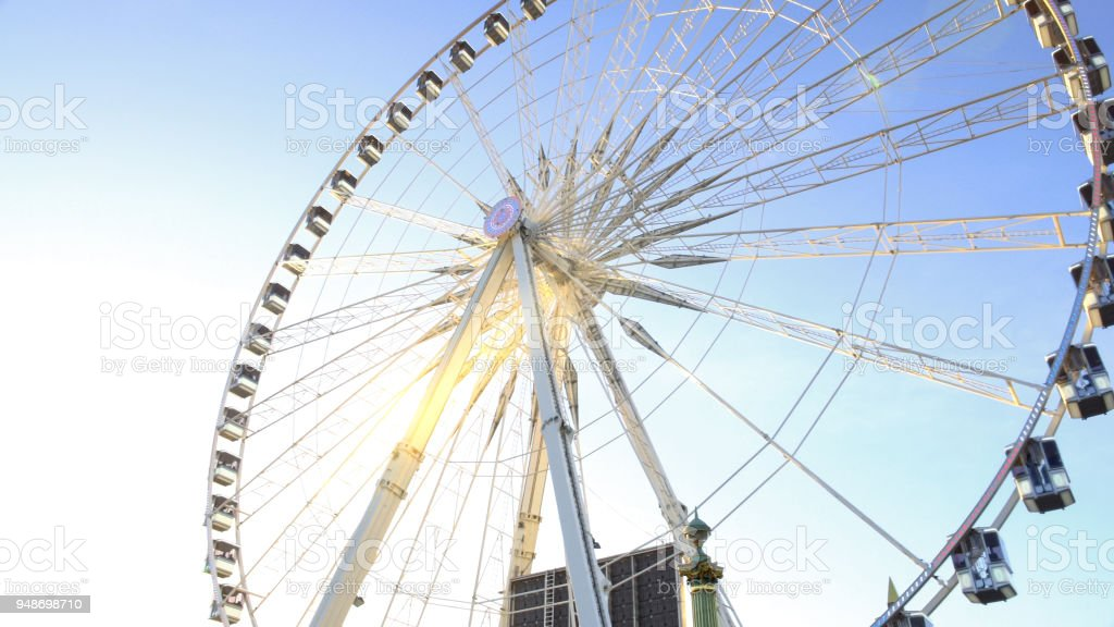 Huge Ferris wheel against blue sky background, beautiful sunny day in theme park stock photo