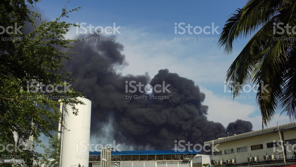 huge fire blaze from burning oil factory in Bangkok Thailand stock photo