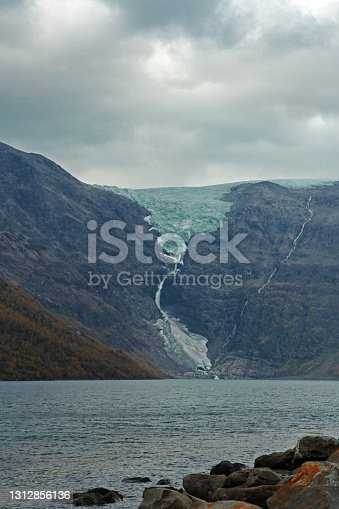 istock Huge glacier melts into the sea. 1312856136