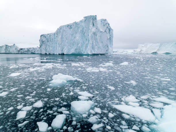 huge glaciers are on the arctic ocean in ilulissat, greenland - smelten stockfoto's en -beelden