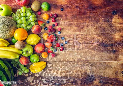 istock Huge Group of Fresh Fruits on Wooden Background 542302774