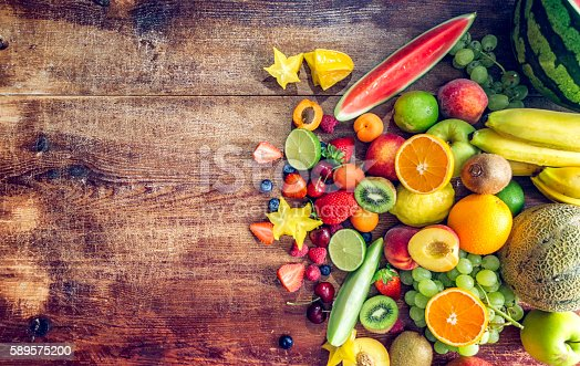 istock Huge Group of Fresh Fruits on Wooden Background 589575200