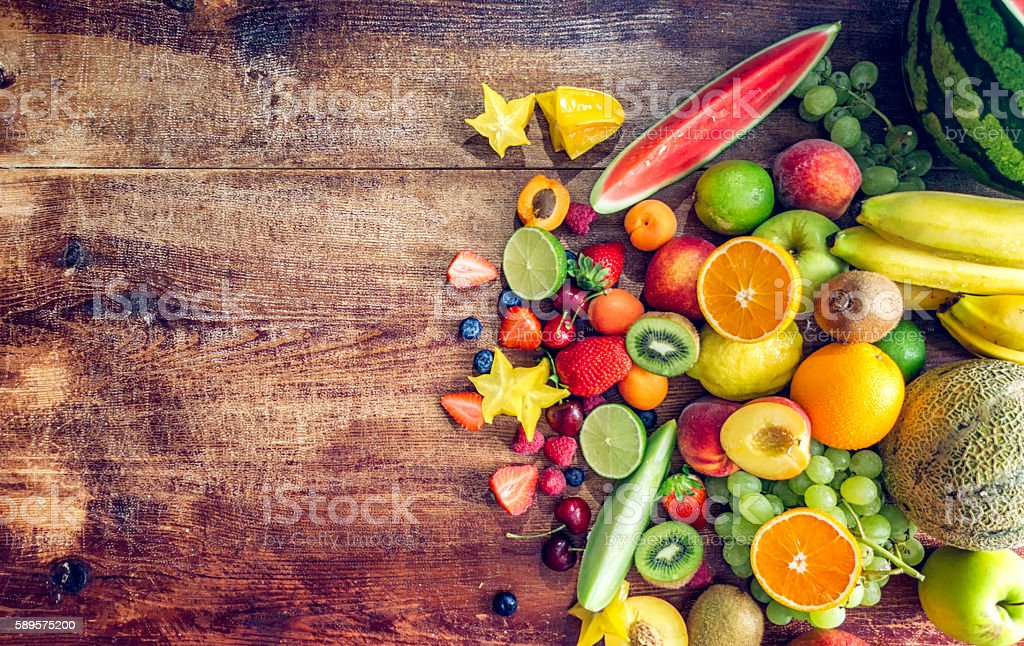 Huge Group of Fresh Fruits on Wooden Background stock photo