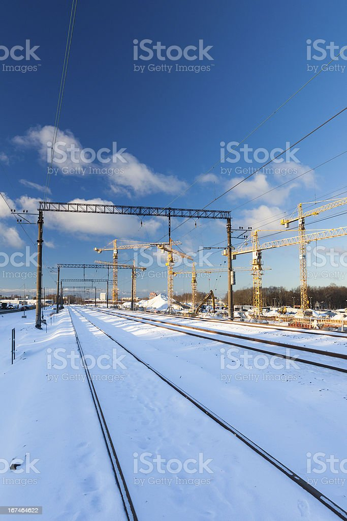 Huge industrial cranes on the construction site royalty-free stock photo