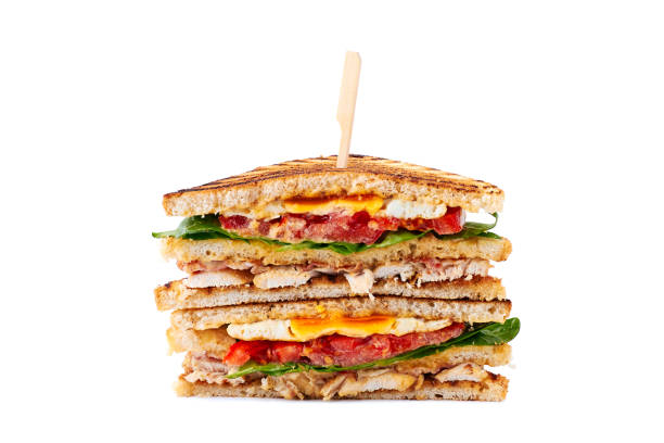 huge juicy club sandwich with chicken and fried egg on white - club sandwich stock photos and pictures