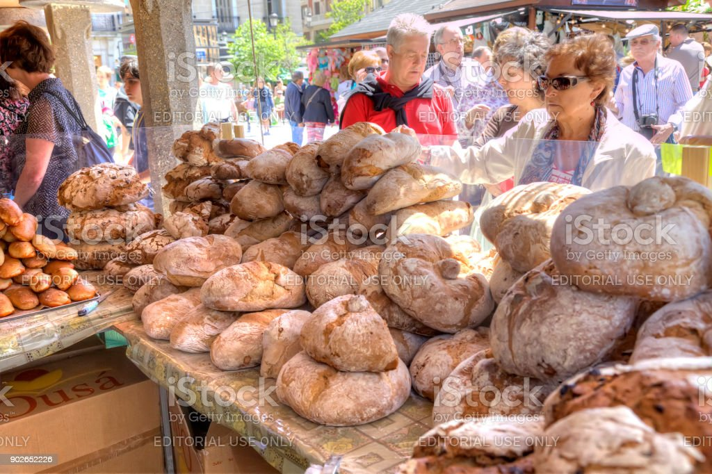 Huge loaves of black bread on the counter in the store stock photo