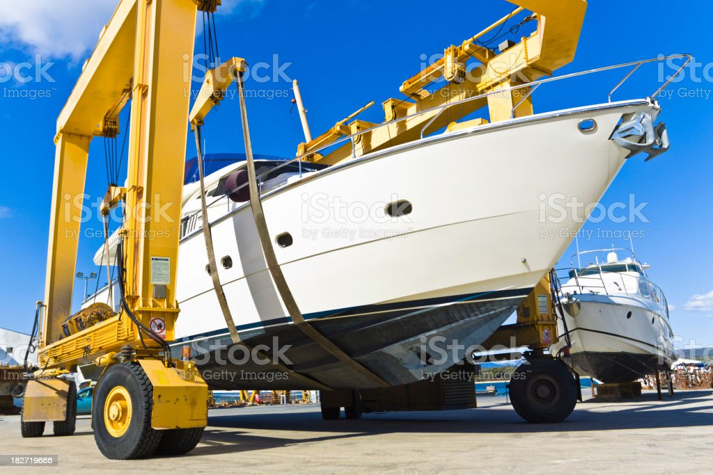 A huge luxury boat on a yellow winch stock photo