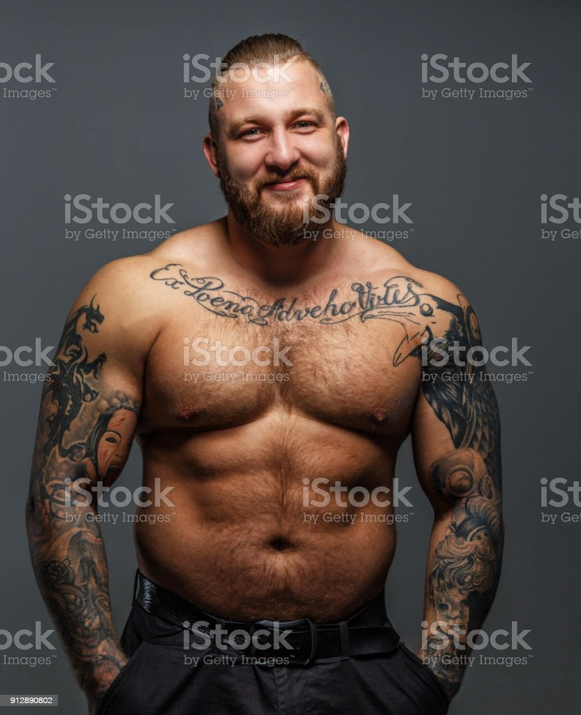 huge man with tattoos and beard smiling stock photo more pictures