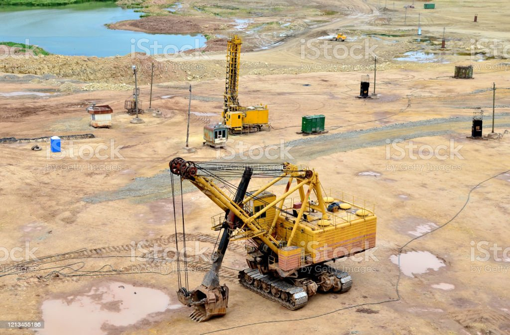Huge Mining Excavator In The Limestone Openpit Biggest Digger Working In Dolomite Quarry Largest Tracked Machine With Electric Shovel Heavy Duty Electricpowered Mining Equipment Stock Photo Download Image Now Istock