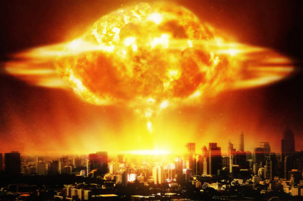 Huge nuclear explosion over a modern city stock photo