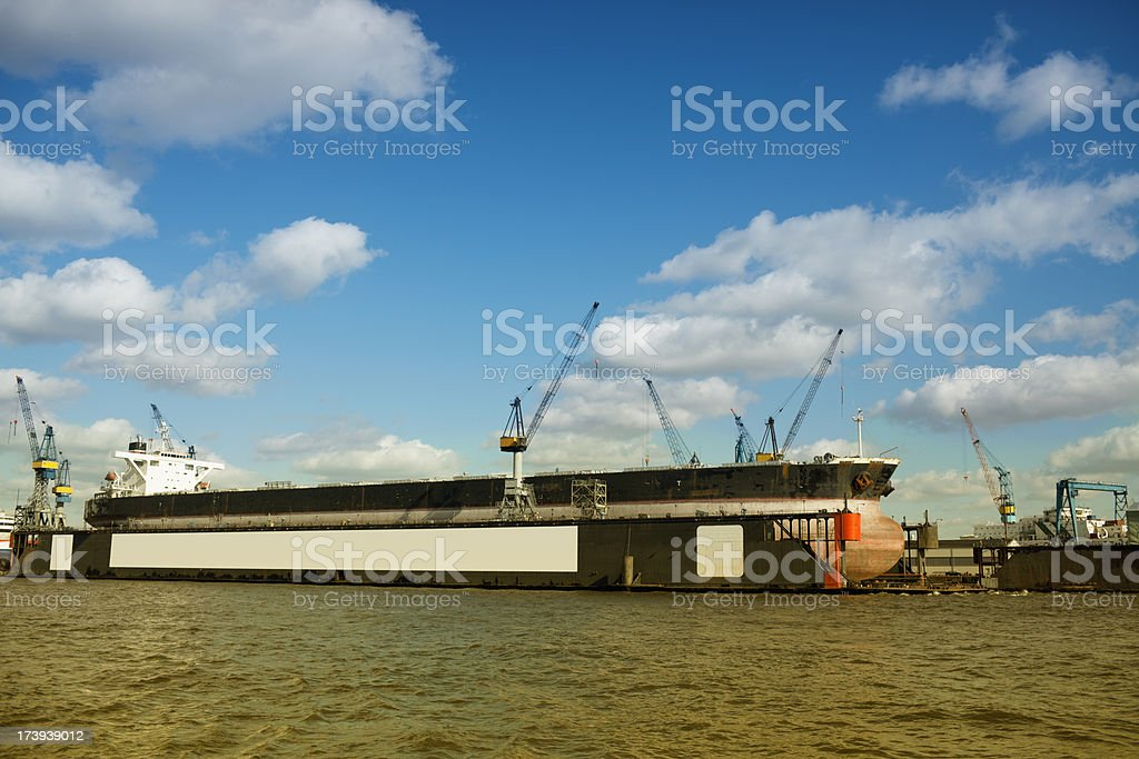 huge oil tanker in the dry dock with copy space royalty-free stock photo