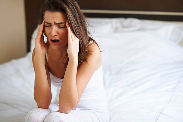 Huge pain of head after waking up Huge pain of head after waking up aftereffect stock pictures, royalty-free photos & images