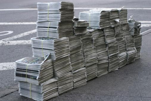 Huge pile of free newspapers