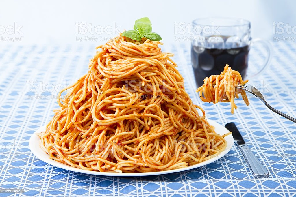 Huge Pile Of Spaghetti On Plate and Twirled Around Fork stock photo