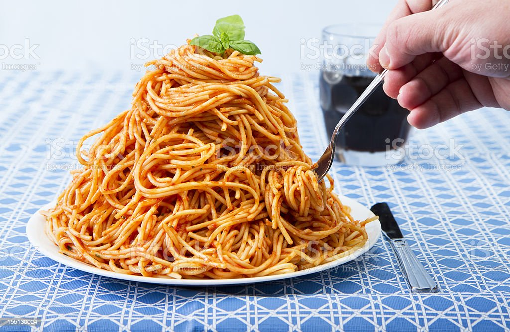 Huge Pile Of Spaghetti On Plate stock photo
