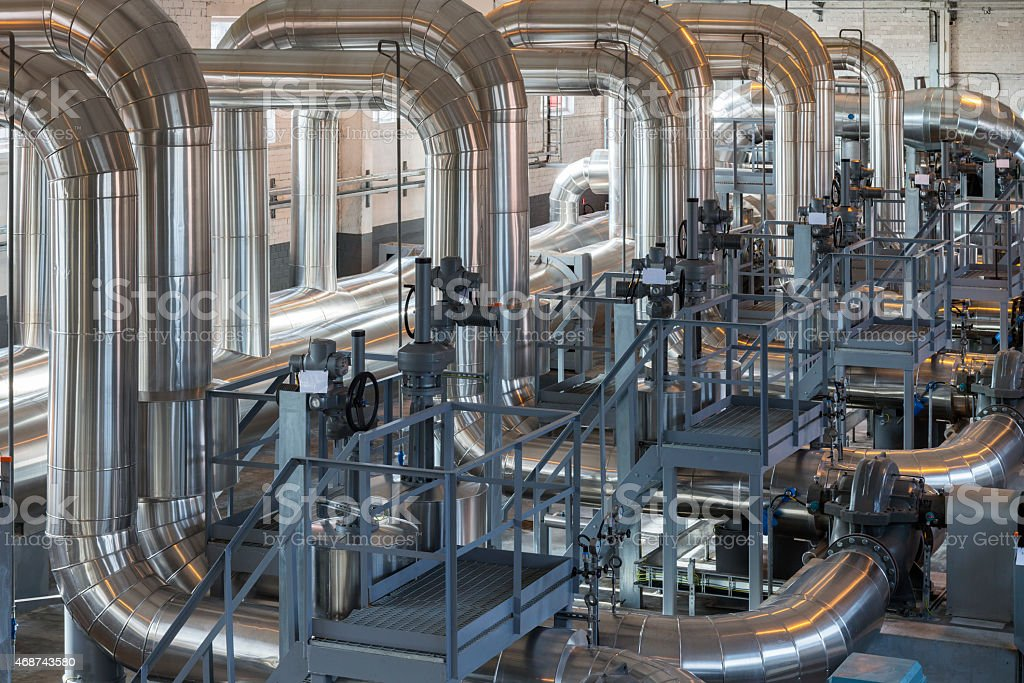 Huge pipes inside a pumping station stock photo