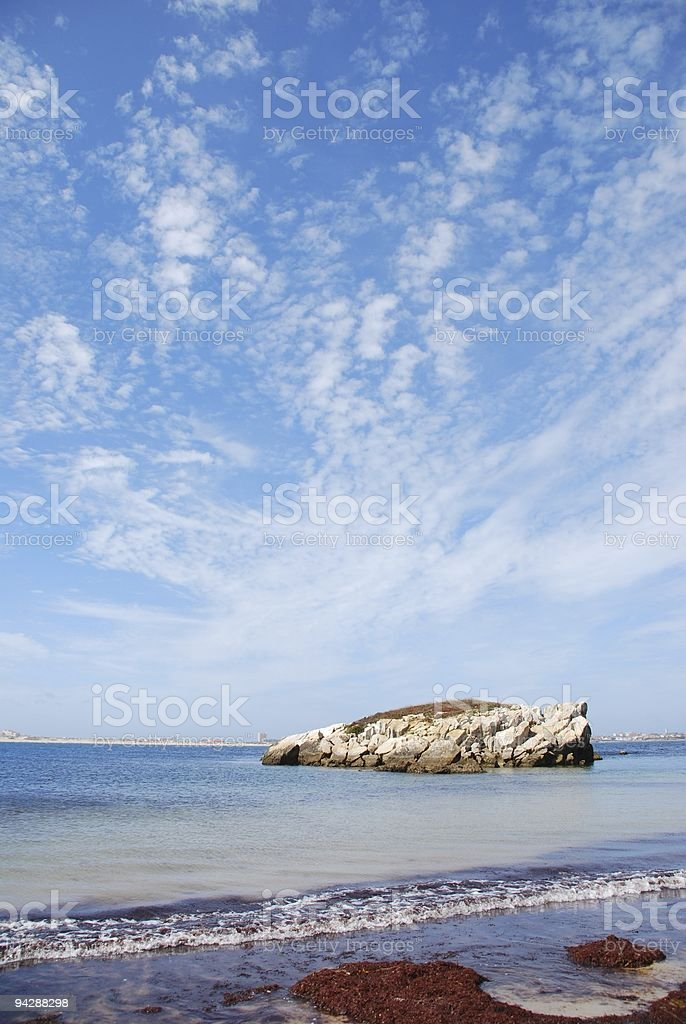 Huge rock at Baleal beach (dramatic cloudscape) royalty-free stock photo