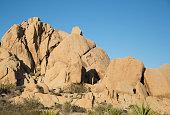 Huge rocks against blue sky at Joshua Tree National Park in California