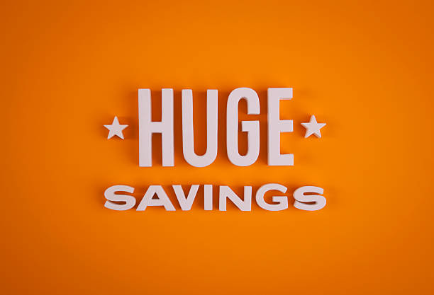 Huge Savings sign lettering stock photo