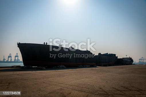 Huge ship wreck in industrial dock