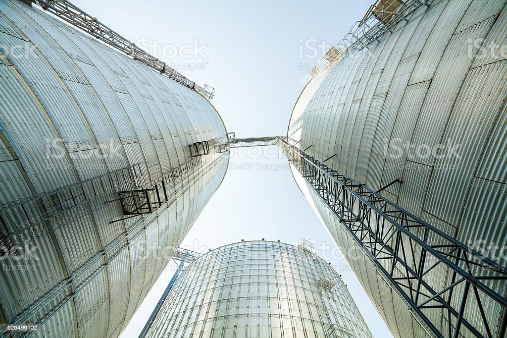 Huge, silver, shining agricultural silos. stock photo