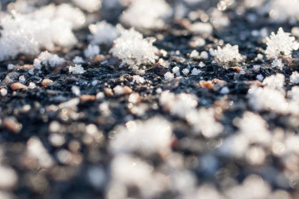 Huge snow flakes on ground surface. stock photo