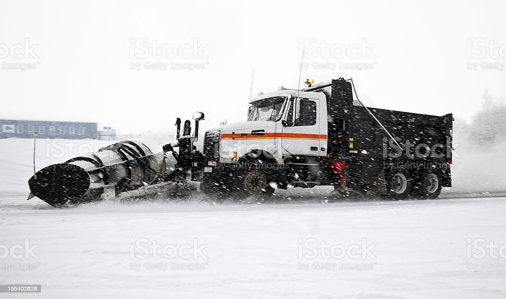 huge snow plow clearing the highway during storm royalty-free stock photo
