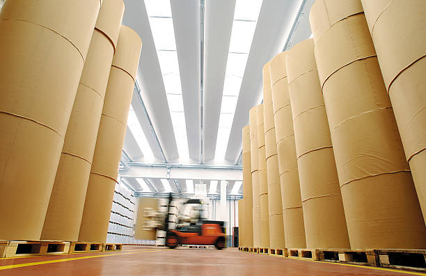 Huge spools of paper in warehouse of a printing company stock photo