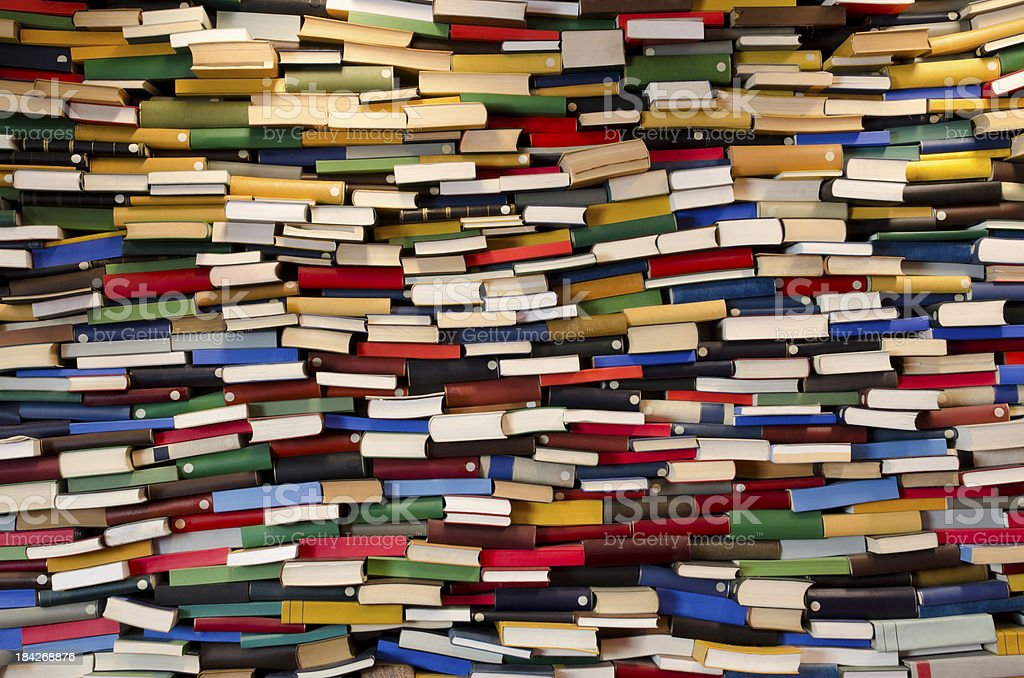 Huge stack of books - Book wall stock photo