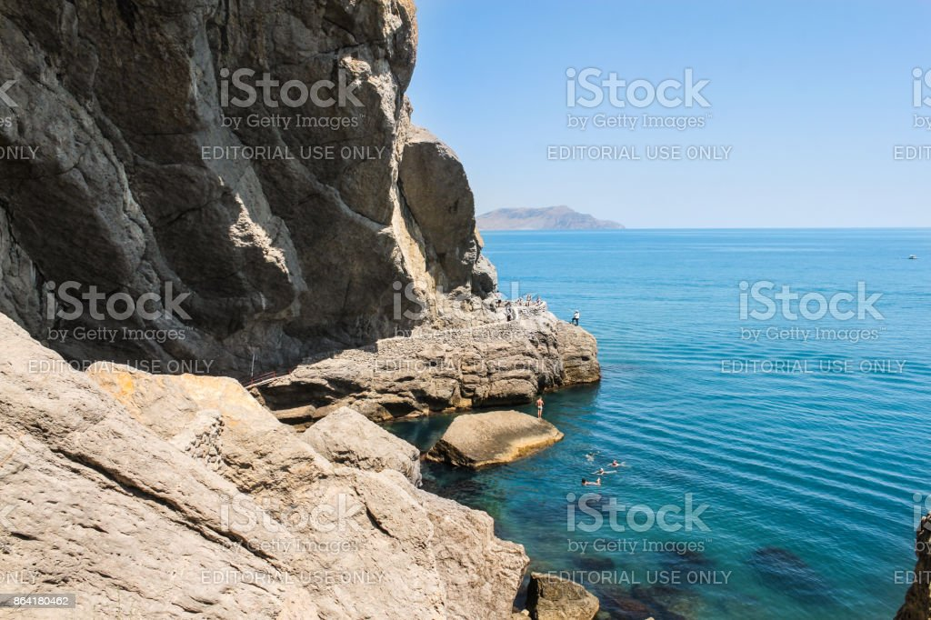 A huge stone rock by the sea. royalty-free stock photo