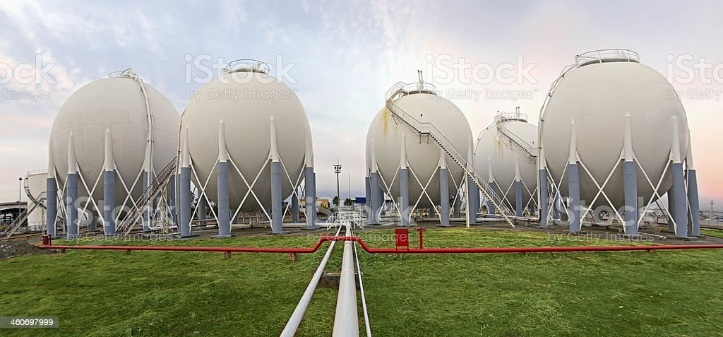 Huge storage tanks of a petrochemical plant stock photo