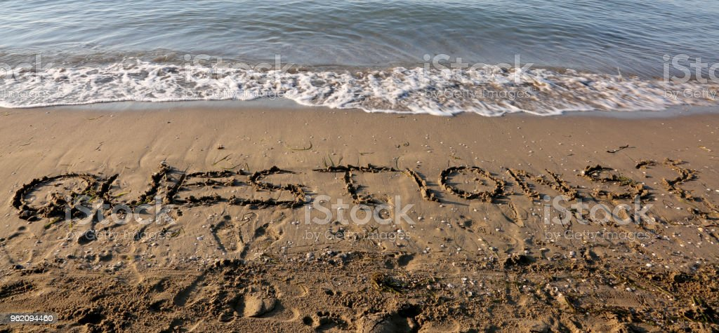 huge text QUESTIONS on the  beach stock photo