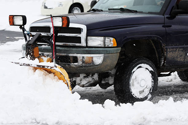 huge truck with plow removing snow stock photo