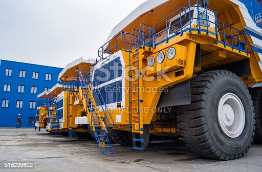 istock Huge Trucks BelAZ In A Row 516239622