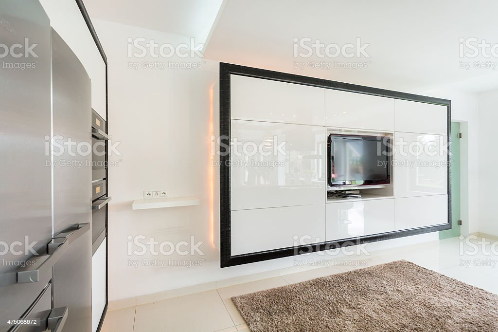 Huge TV on the wall in living room stock photo