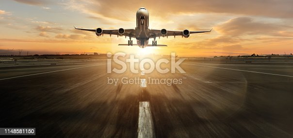 Huge two storeys commercial jetliner taking off. Modern and fastest mode of transportation. Dramatic sunset sky on background