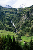 Huge waterfall winds its way into the valley, Austria