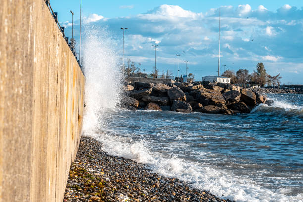 Huge waves crashing over seawall at daytime in Istanbul stock photo